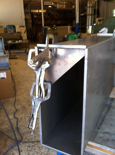 Custom metal duct in factory with clamps